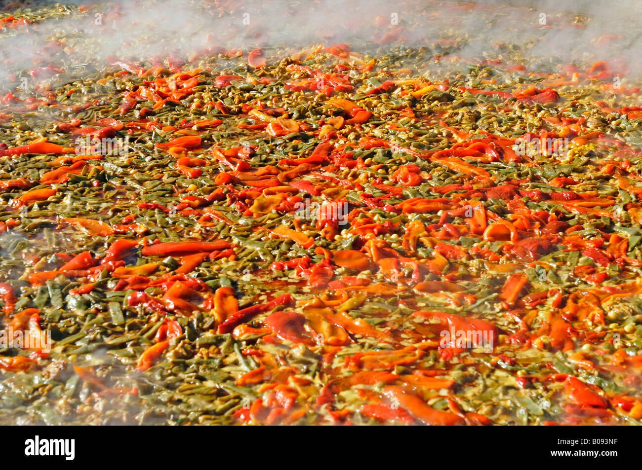 Paella served during fiesta, Altea la Vella, Alicante, Costa Blanca, Spain - Stock Image