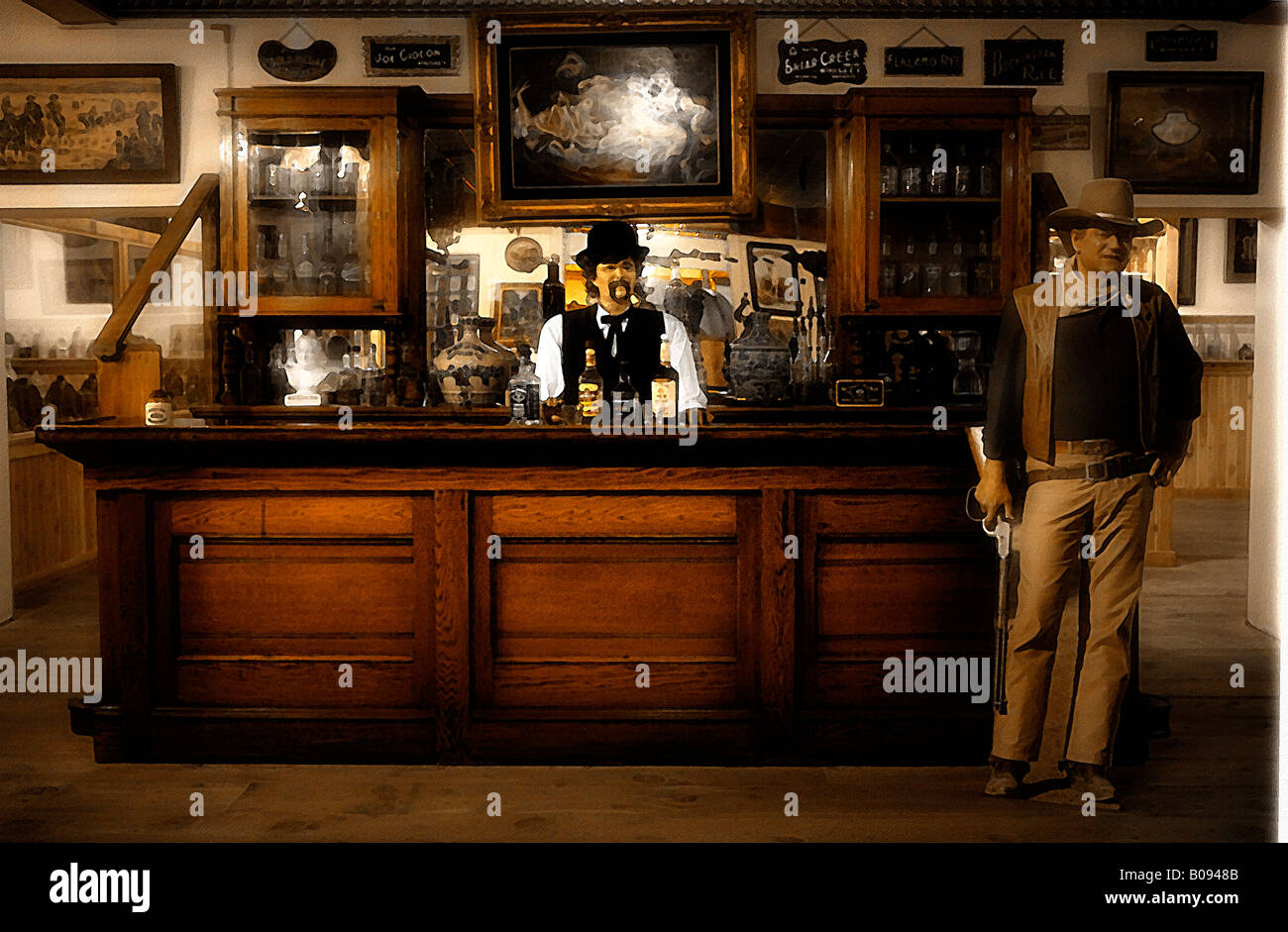 Image of a manikin bartender behind a vintage western saloon counter with a cardboard figurine of John Wayne standing - Stock Image
