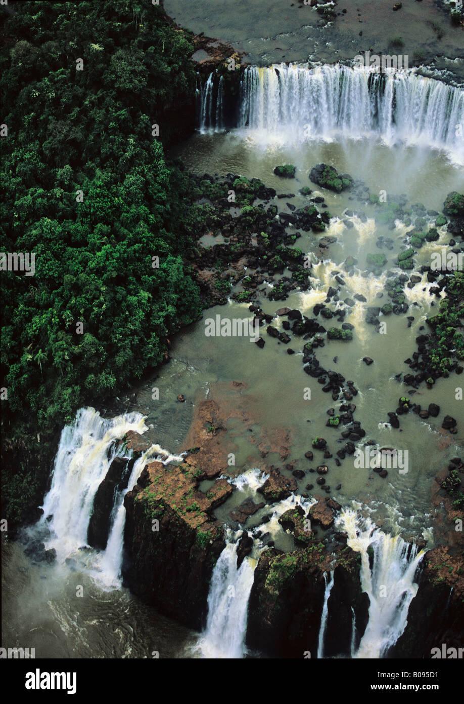 South America, Brazil, Argentina, Igwazu, Igwacu Falls thunder into the Igwacu River below. Stock Photo