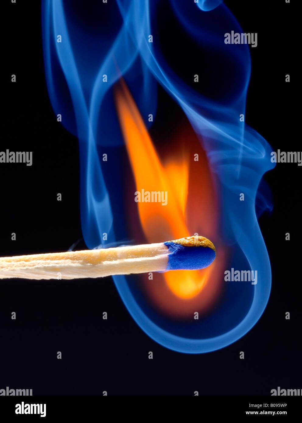 Smoke rising from a lit match, burning match - Stock Image