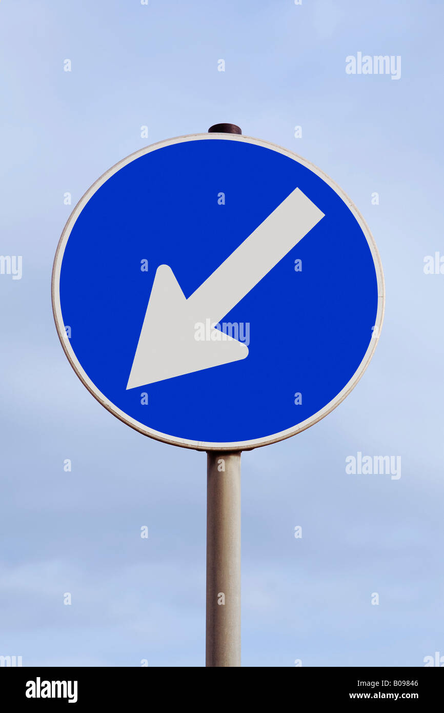 Traffic sign with an arrow pointing down and to the left, decline, declining, descent, southwest - Stock Image