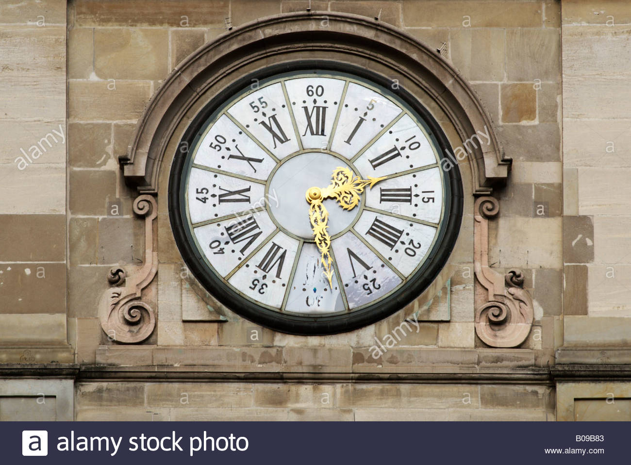 Clock on the outside wall of a building in Geneva, Switzerland - Stock Image