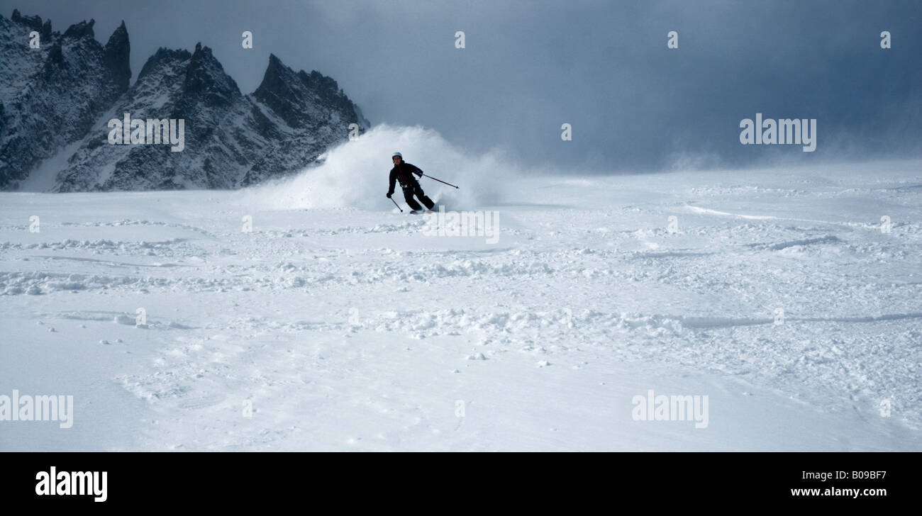 High speed off-piste skiing with fresh powder snow on Rognon Glacier, Grands Montets, Argentiere, France - Stock Image