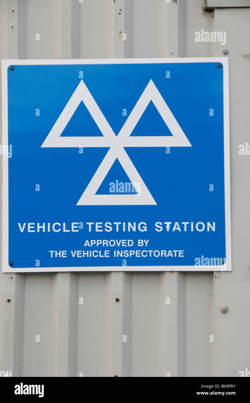 MOT vehicle inspection station sign on a garage wall - Stock Image