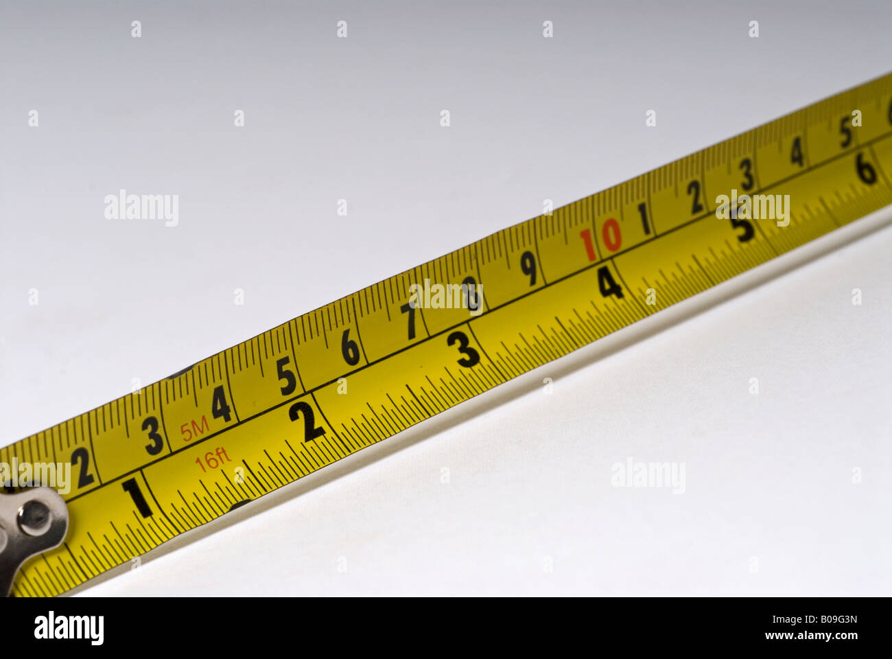 Stock photo of a tape measure showing both the metric and imperial measurements - Stock Image