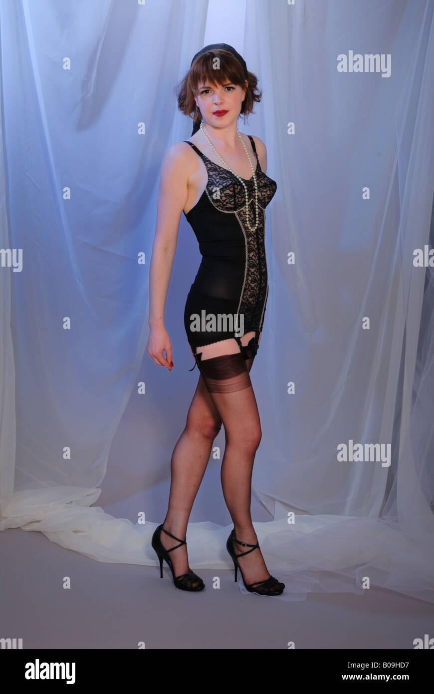 3e1e3dbabd attractive retro fifties pinup girl in vintage black corselette and nylon  stockings