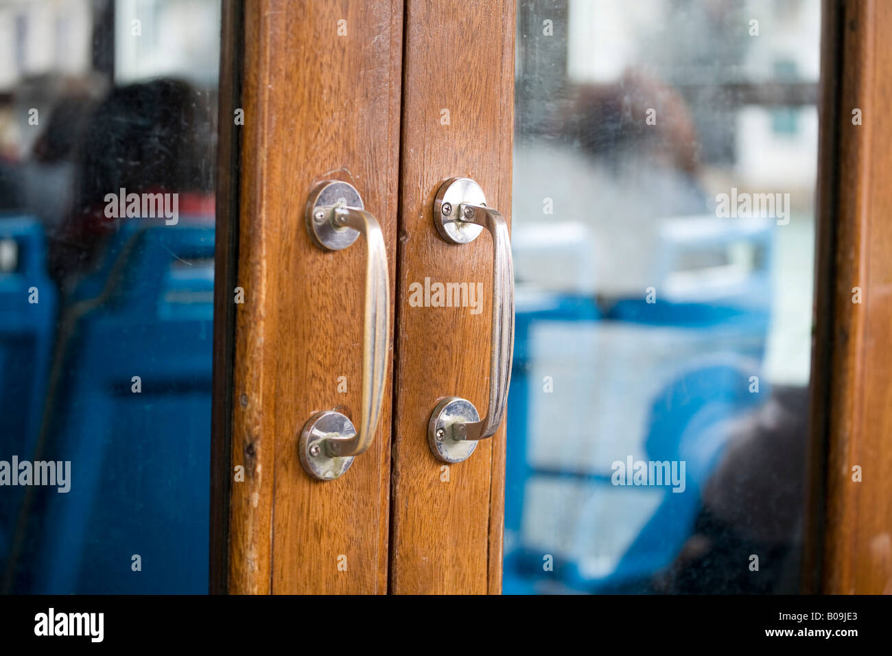wooden doors on a water bus in Venice - Stock Image
