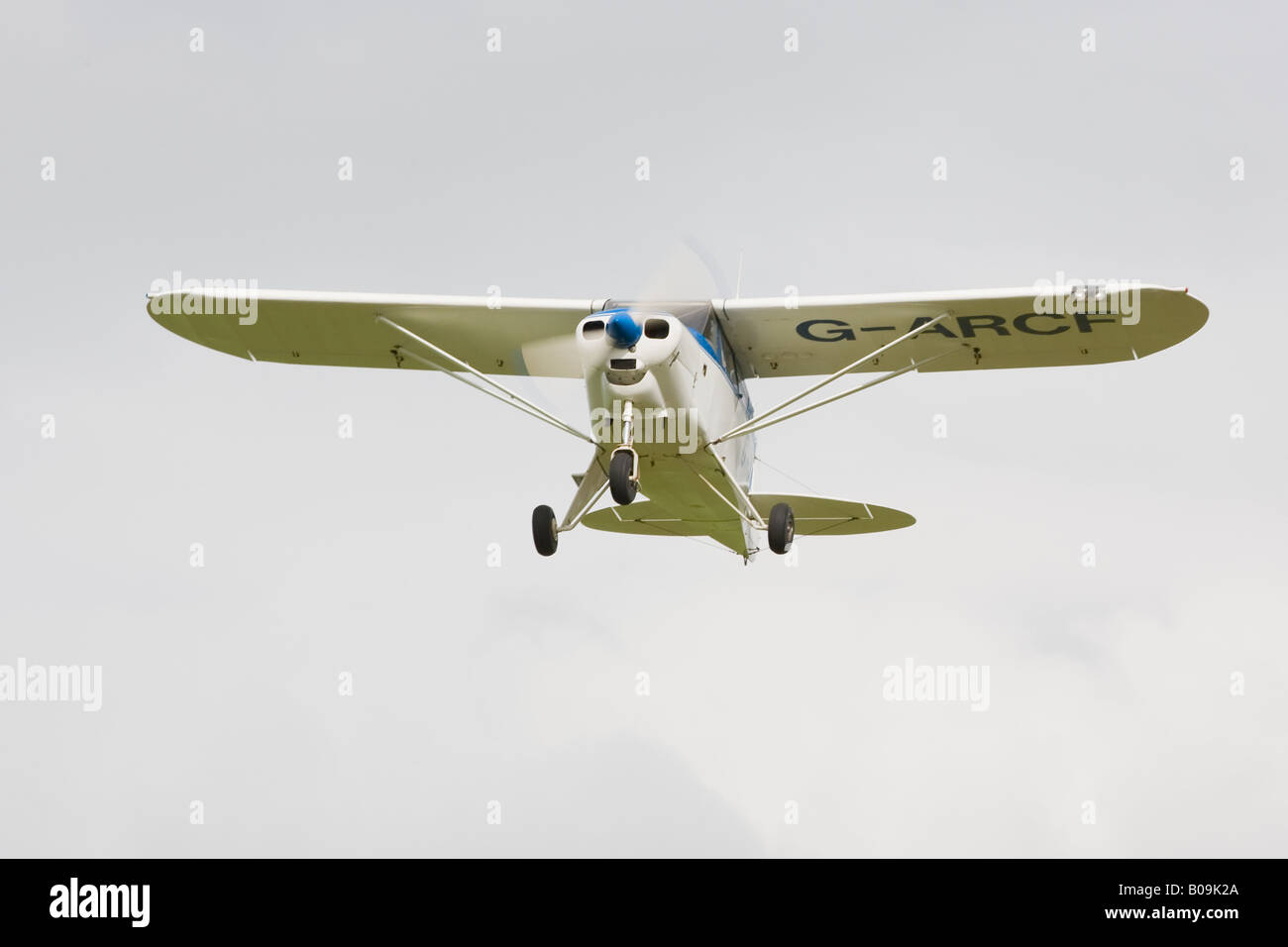 Piper PA-22-150 Caribbean G-ARCF in flight taking off - Stock Image
