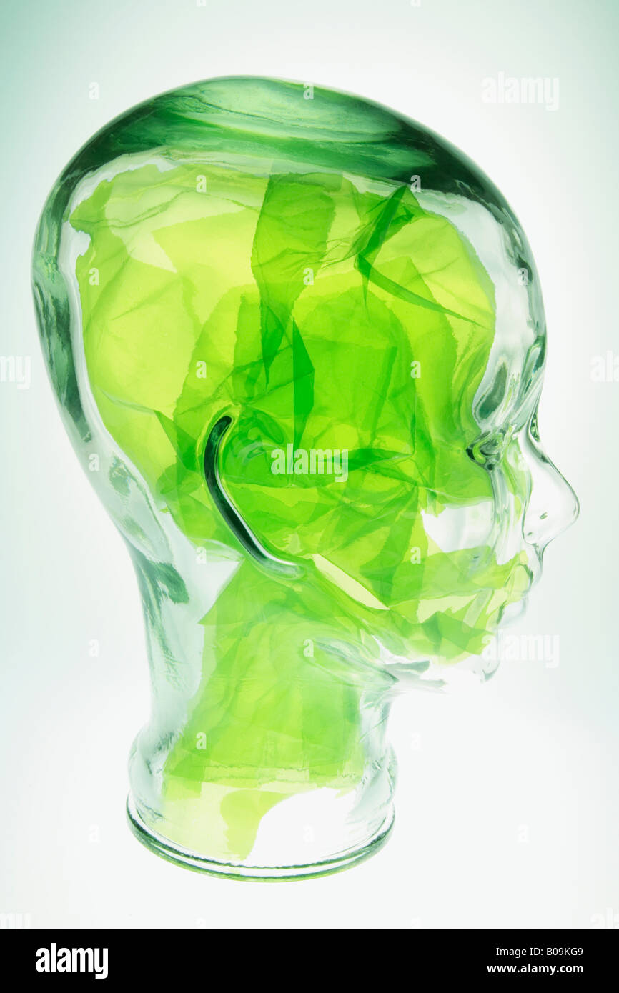 Glass Head Mannequin With Green Cellophane Paper Stock Photo