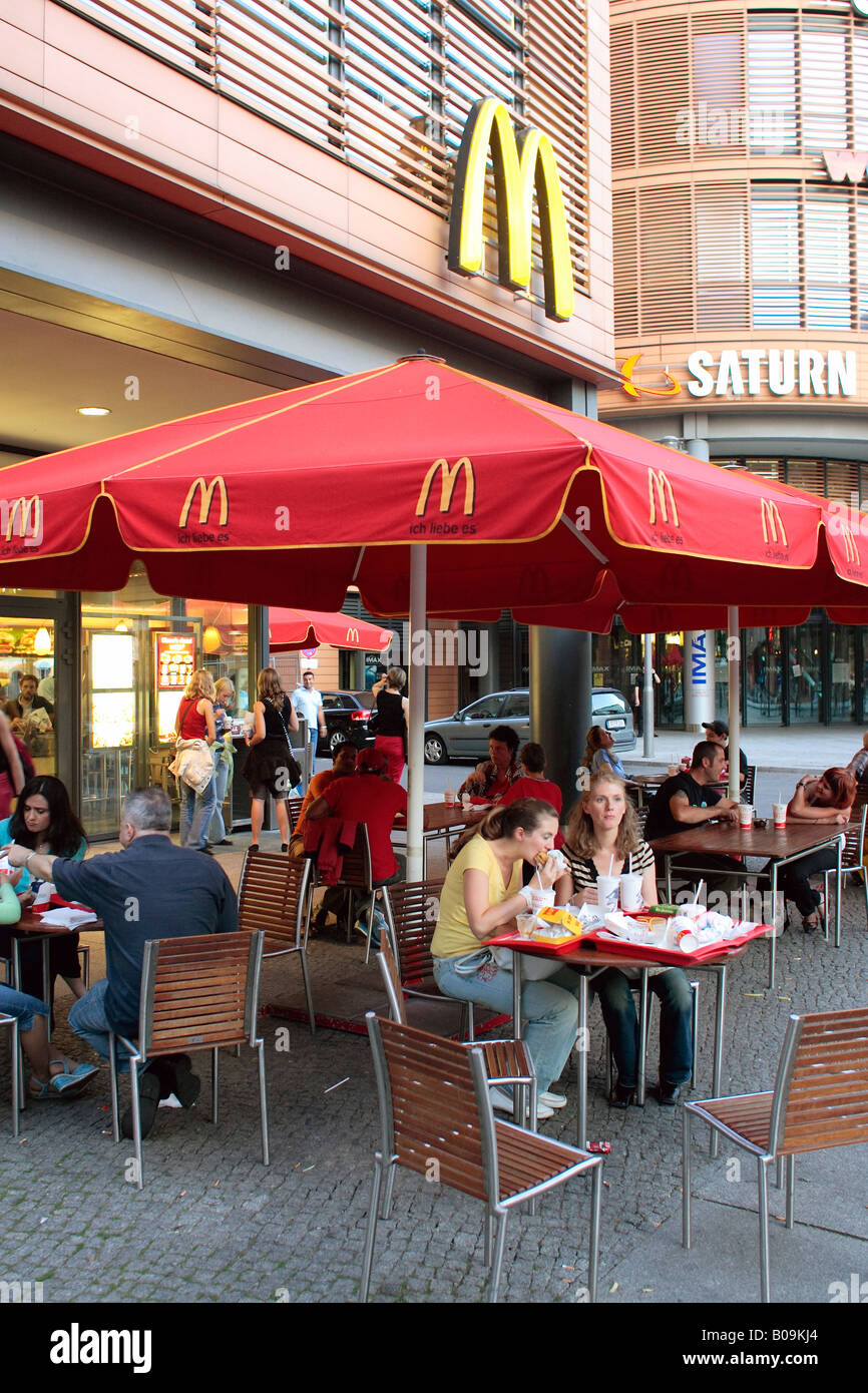 Pedestrians next to McDonalds at the Marlene Dietrich Square, Berlin, Germany - Stock Image