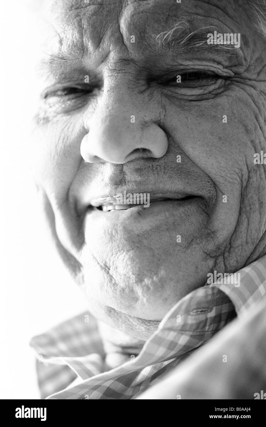 Senior man looking at camera, close-up, portrait - Stock Image