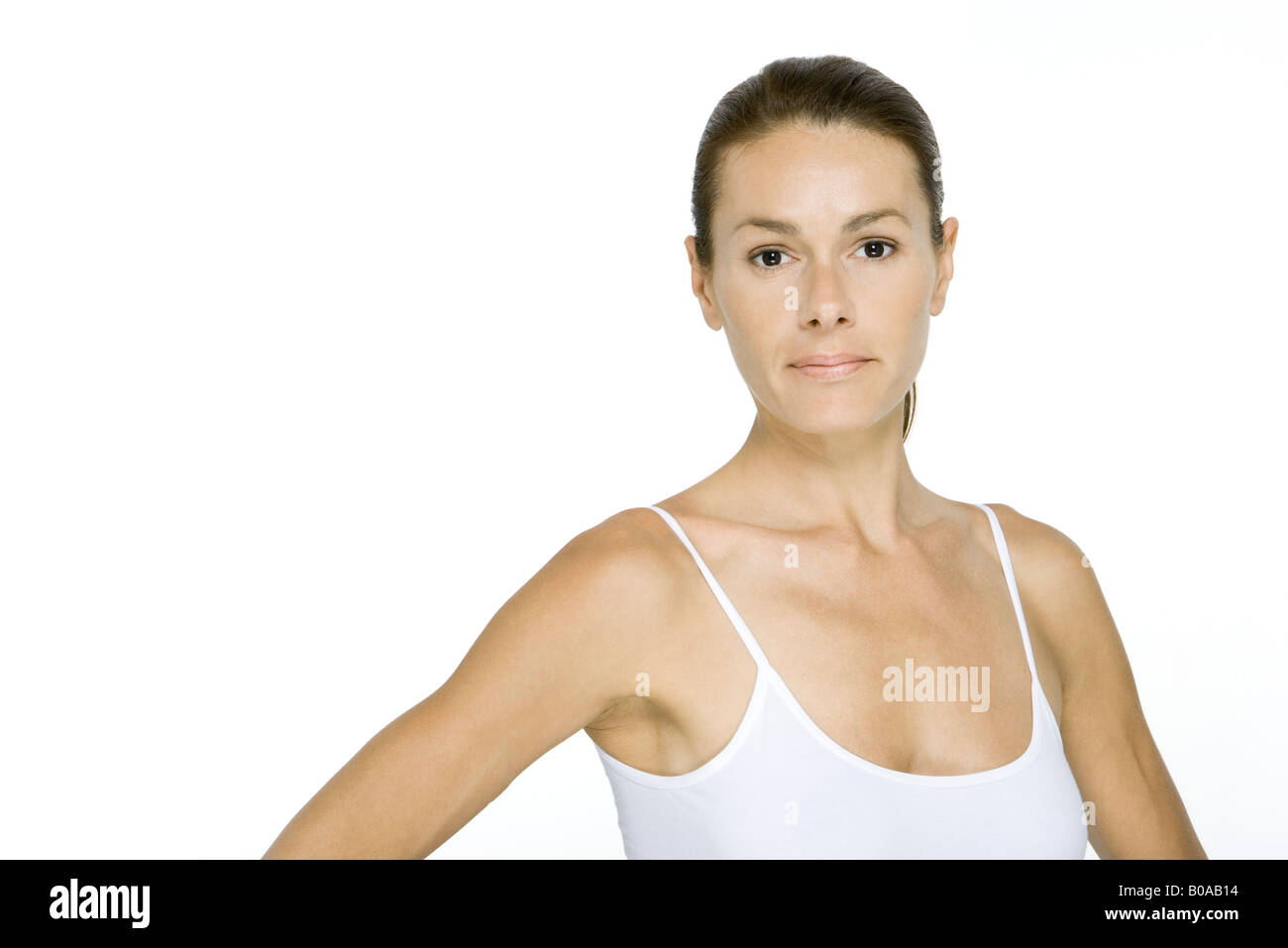 Woman in tank top looking at camera, portrait - Stock Image