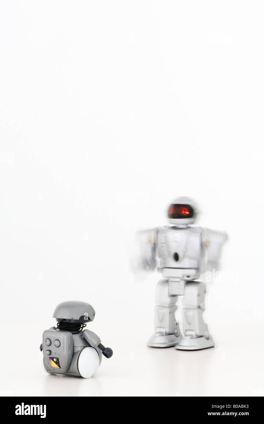 Two robots approaching each other - Stock Image