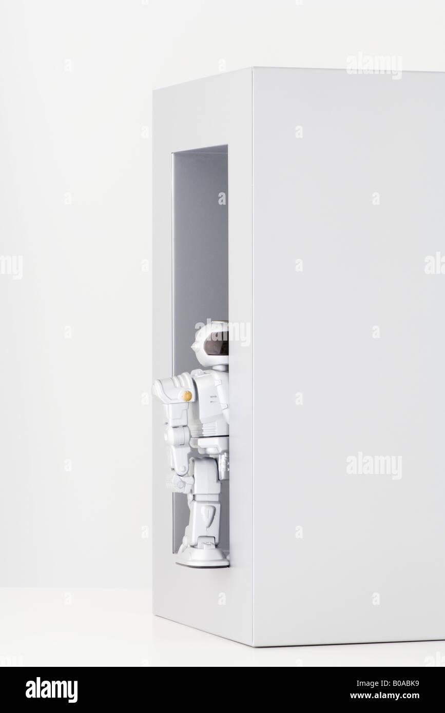 Robot hiding - Stock Image