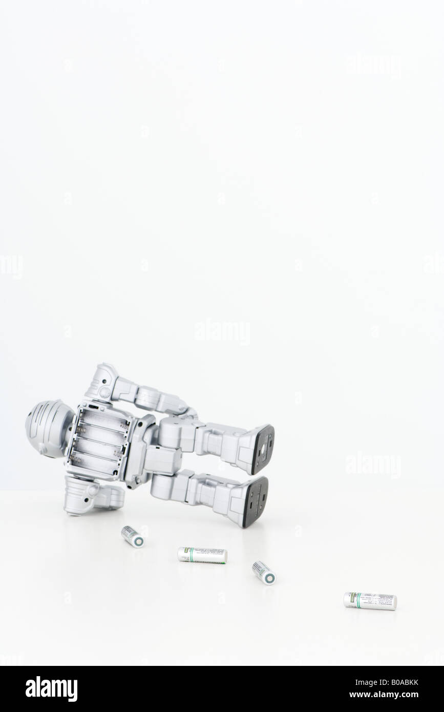 Robot losing its batteries - Stock Image