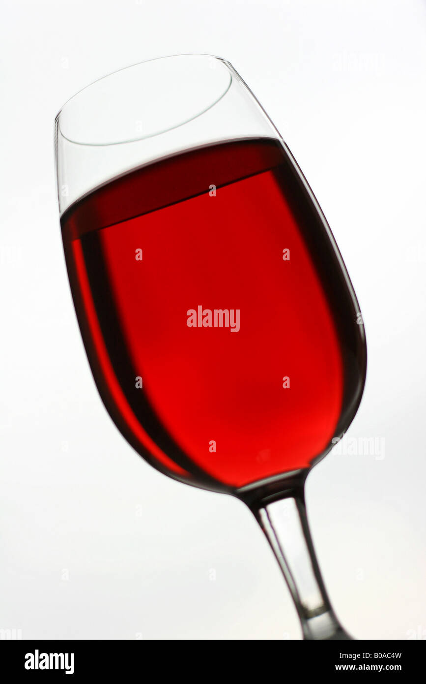 Red wine in glass, close-up - Stock Image