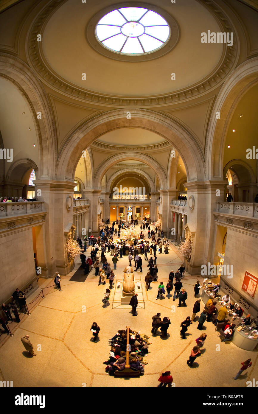 Metropolitan Art entrance hall lobby with welcome and information desk Museum interior New York City NY NYC USA - Stock Image