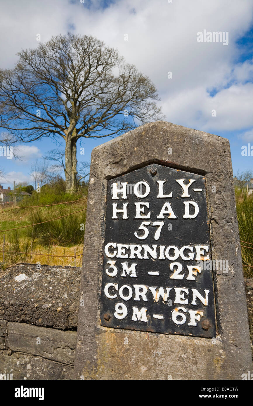 Original old milestone showing beside A5 historic coaching route road to Holyhead built by Thomas Telford. Cerrigydrudion - Stock Image