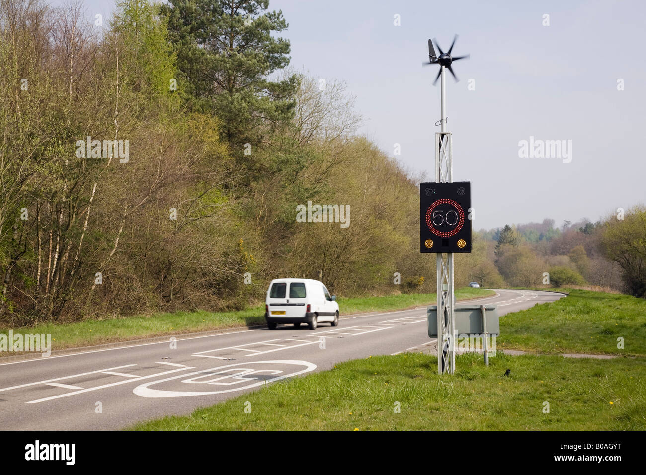 West Sussex England UK Wind powered 50 mph speed sign illuminated by vehicle on country main road Stock Photo