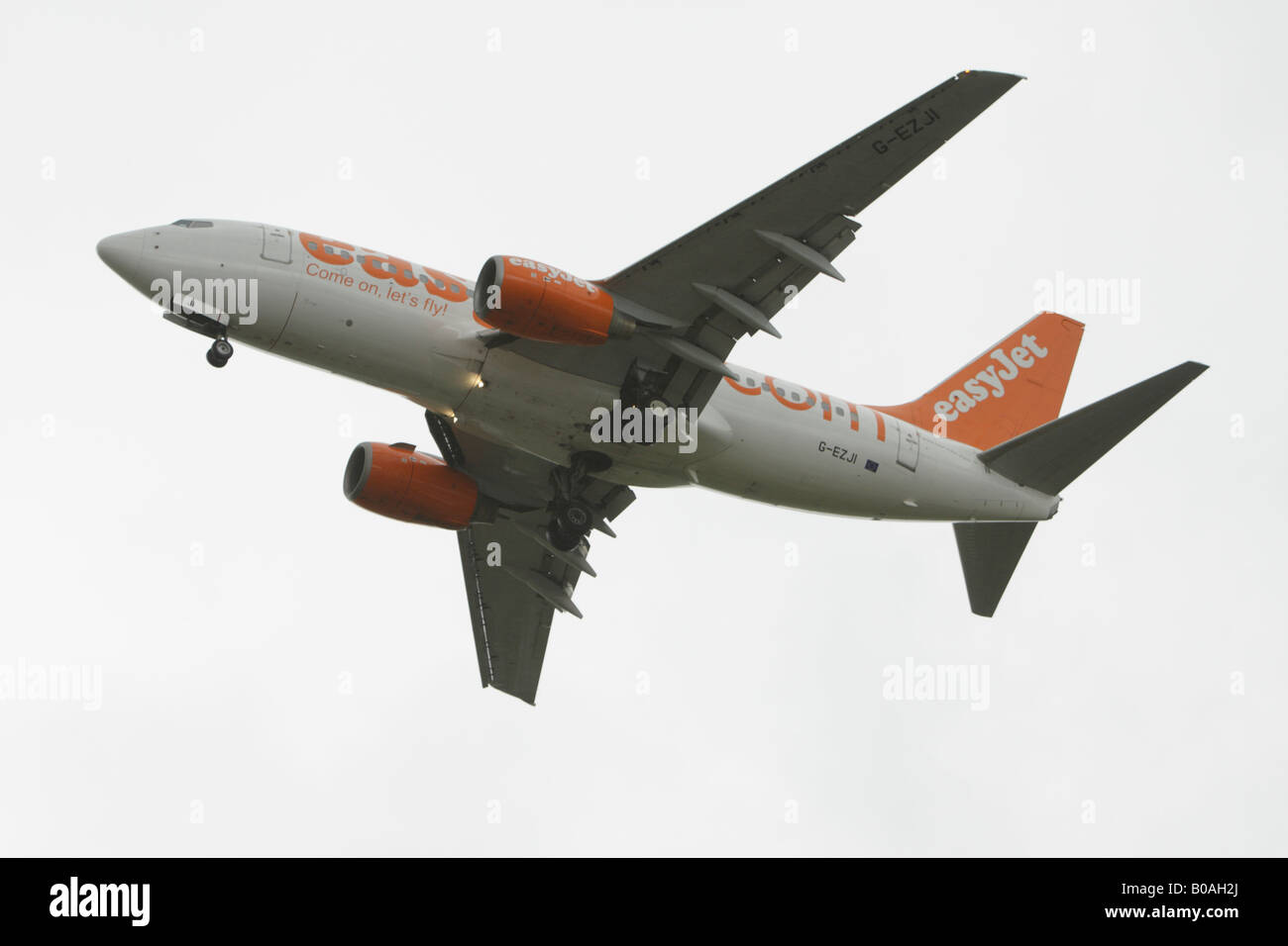 Aircraft on final approach to landing at Luton Airport - Stock Image