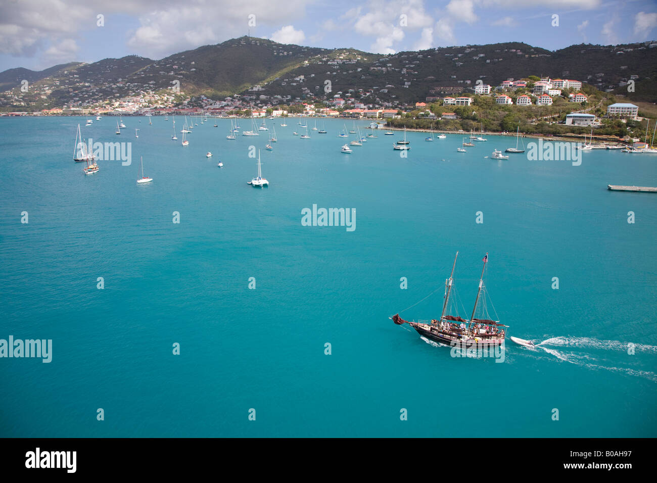 Tourist sail boat in the blue waters of the harbor of St Thomas Charlotte Amalie West Indies Caribbean Stock Photo