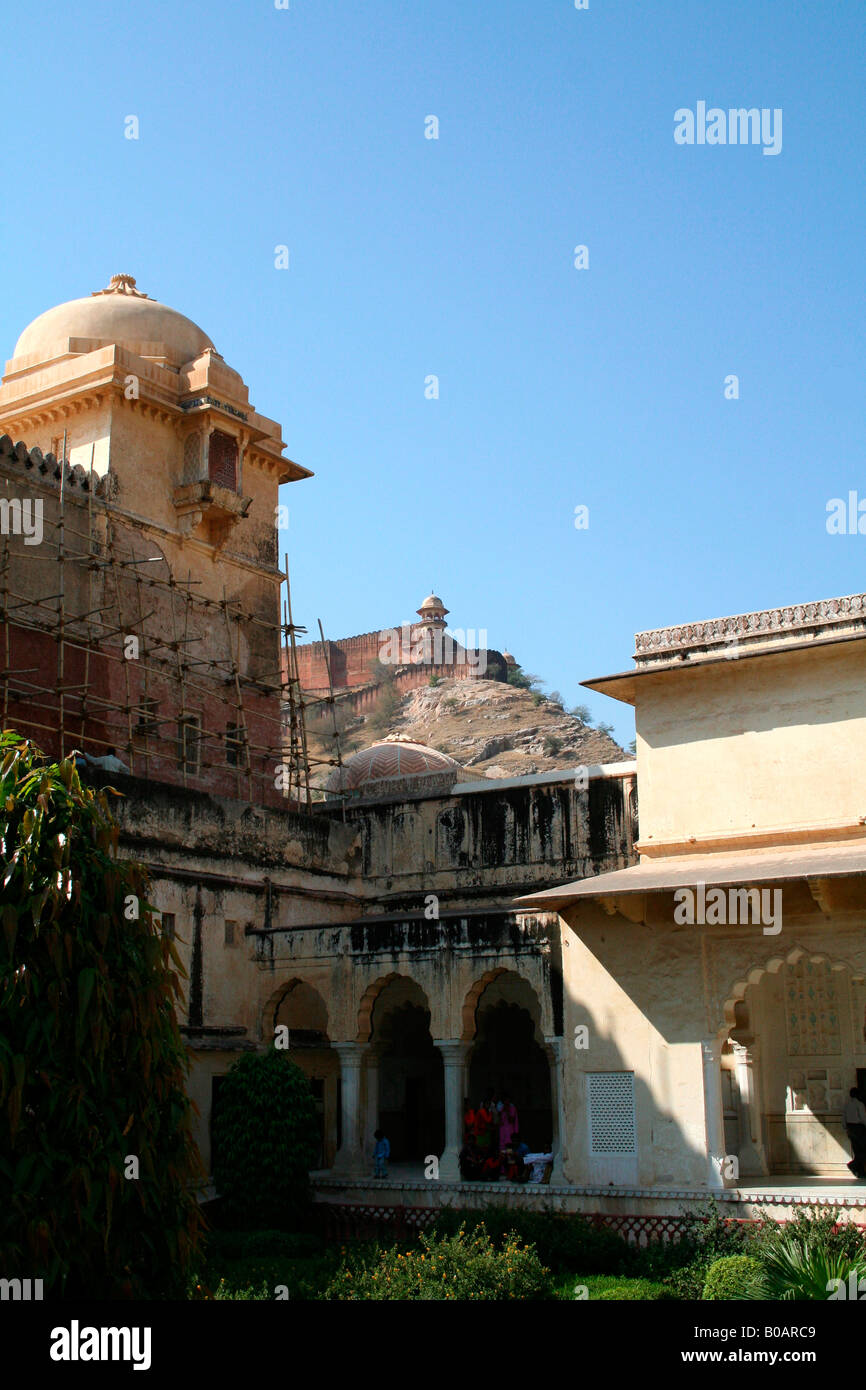Scaffolding in Amber Palace Jaipur which is being renovated - the famous fort can be seen on top of a hill in the - Stock Image
