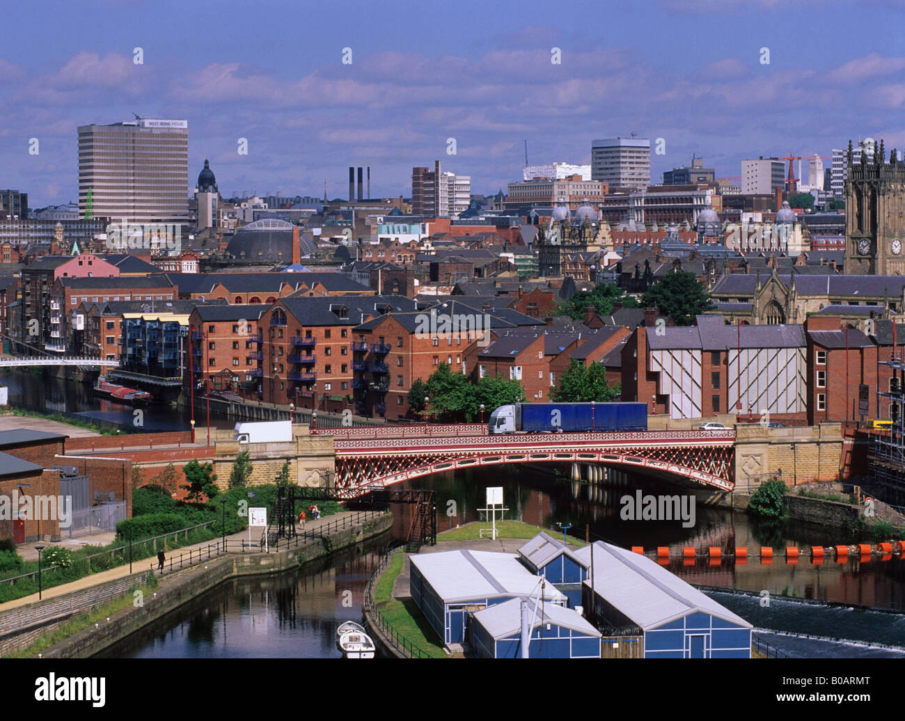 traffic crossing bridge over the River Aire in the city of Leeds Yorkshire UK - Stock Image