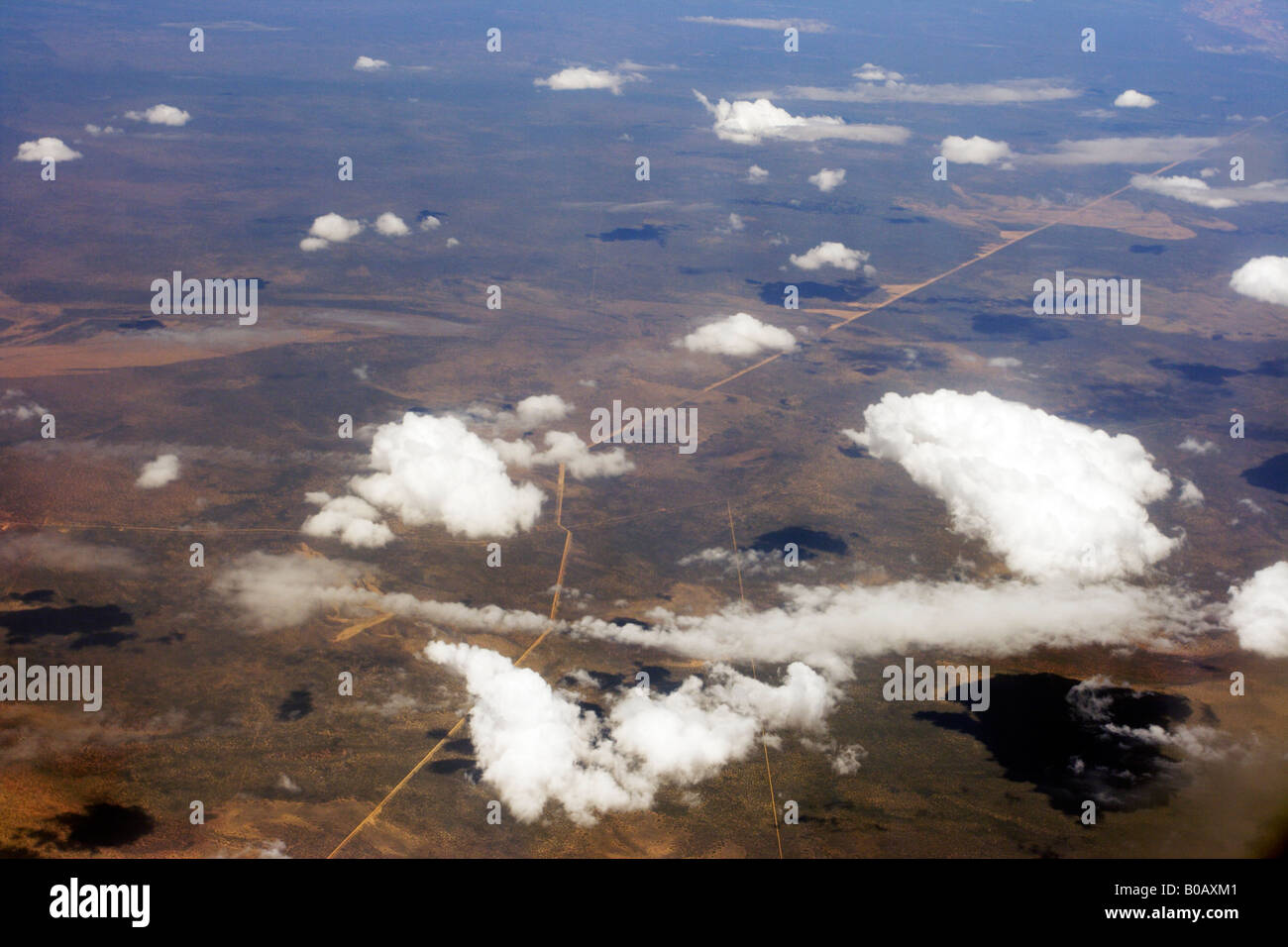 View of a road cutting across the Western Australian desert at 40,000 feet from an airliner. - Stock Image