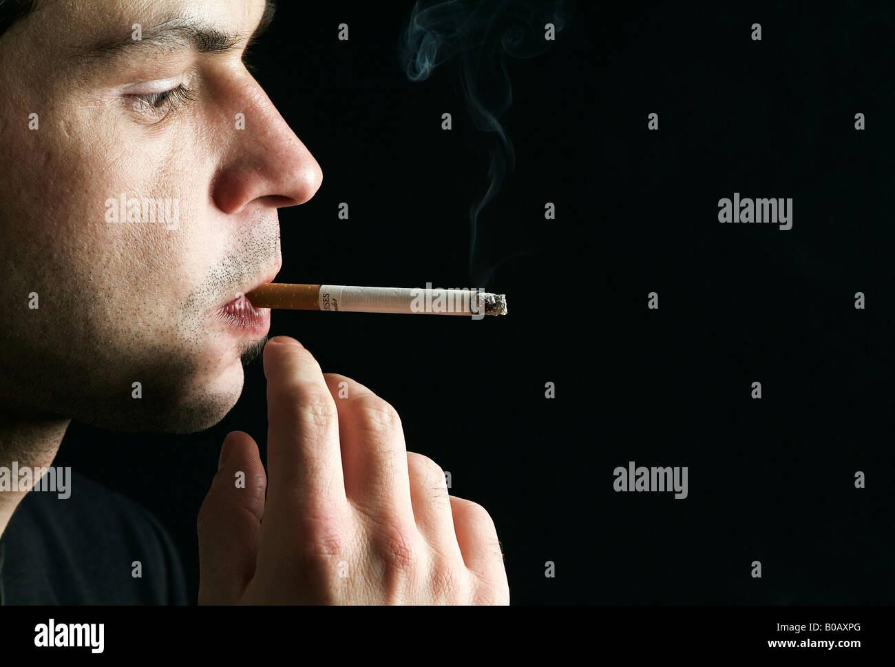 Man smoking a cigarette - Stock Image