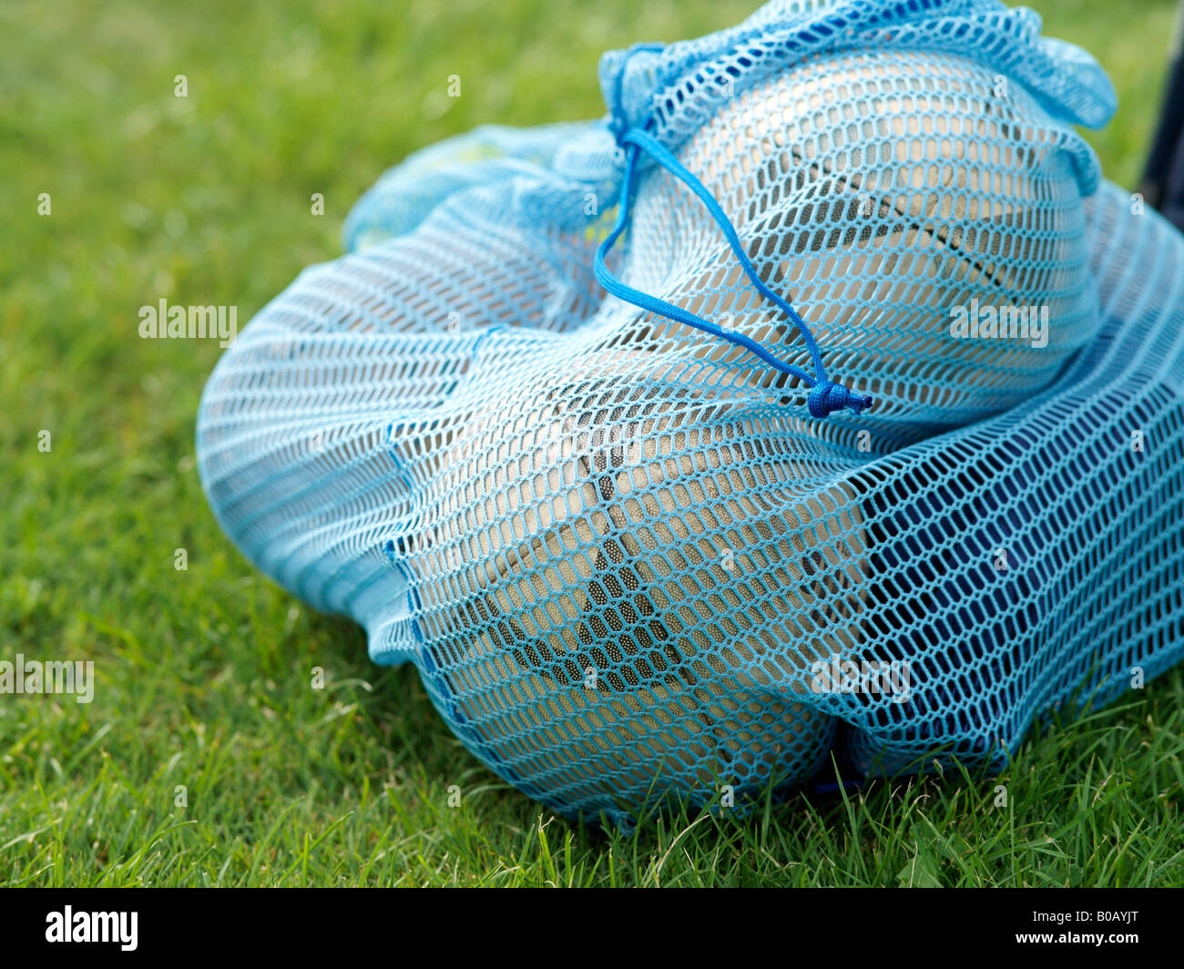 footballs in net bag - Stock Image