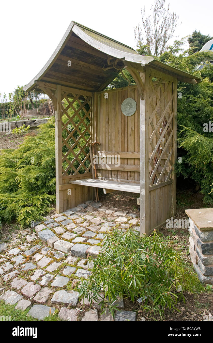 Wooden lattice arbor arbour in landscaped garden Worcestershire UK ...