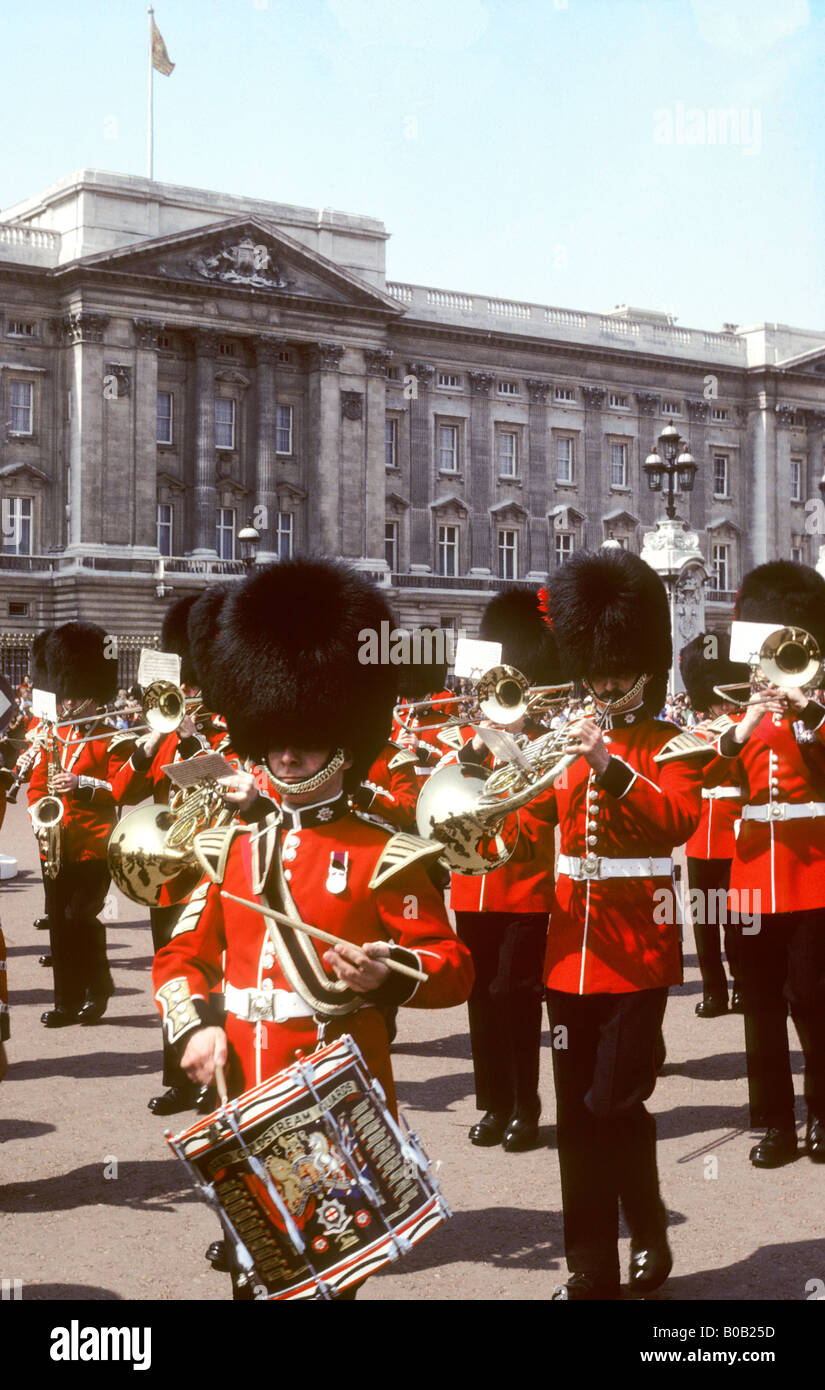 Coldstream Guards Buckingham Palace London England pageantry red tunics bearskins band drums military uniforms UK - Stock Image