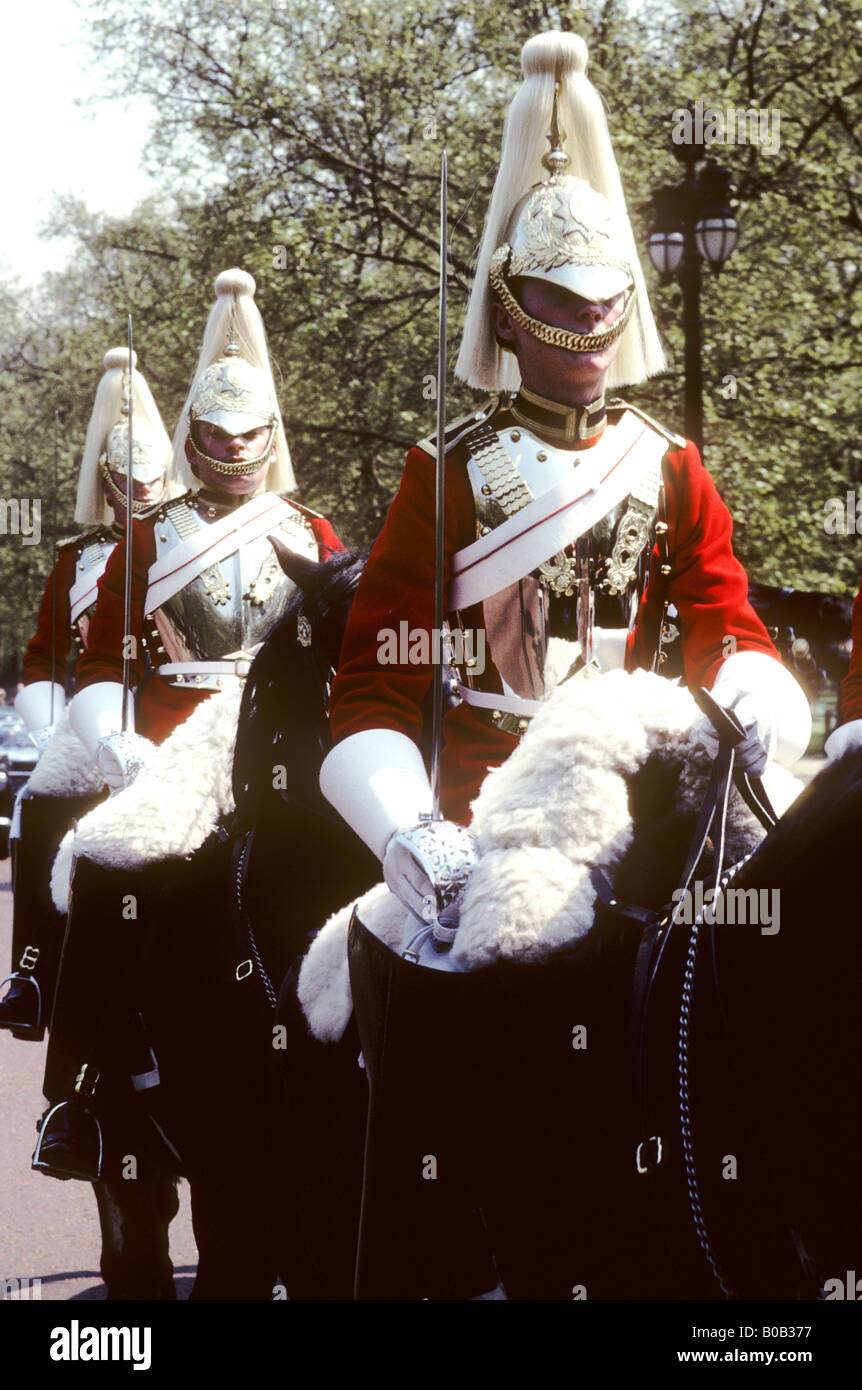 Horseguards in The Mall English British ceremonial army soldiers mounted horses horseback riders uniform red plumes Stock Photo
