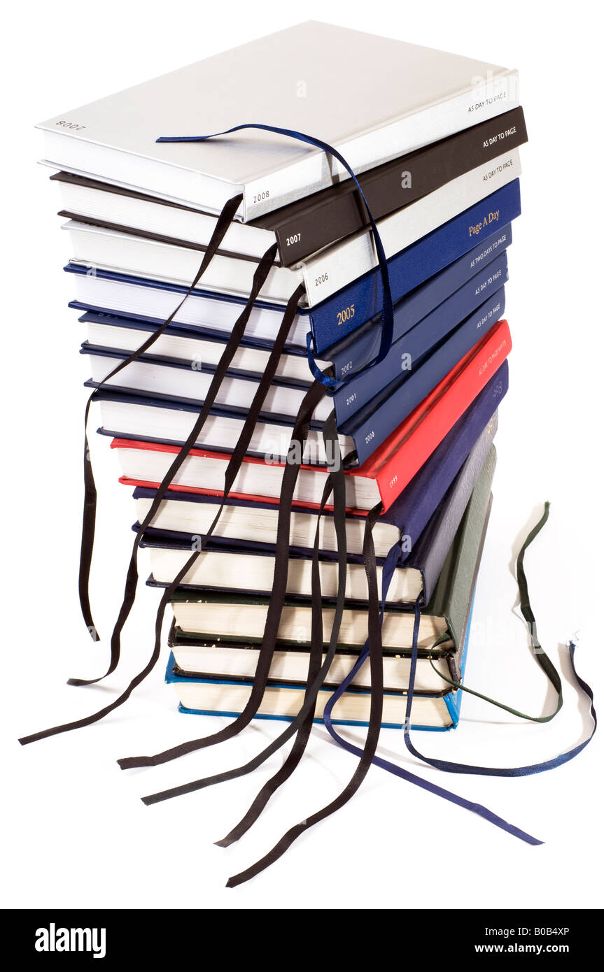 A stack of old and new Diaries - Stock Image