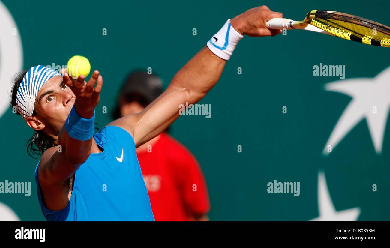 Rafael Nadal serves a winner. - Stock Image
