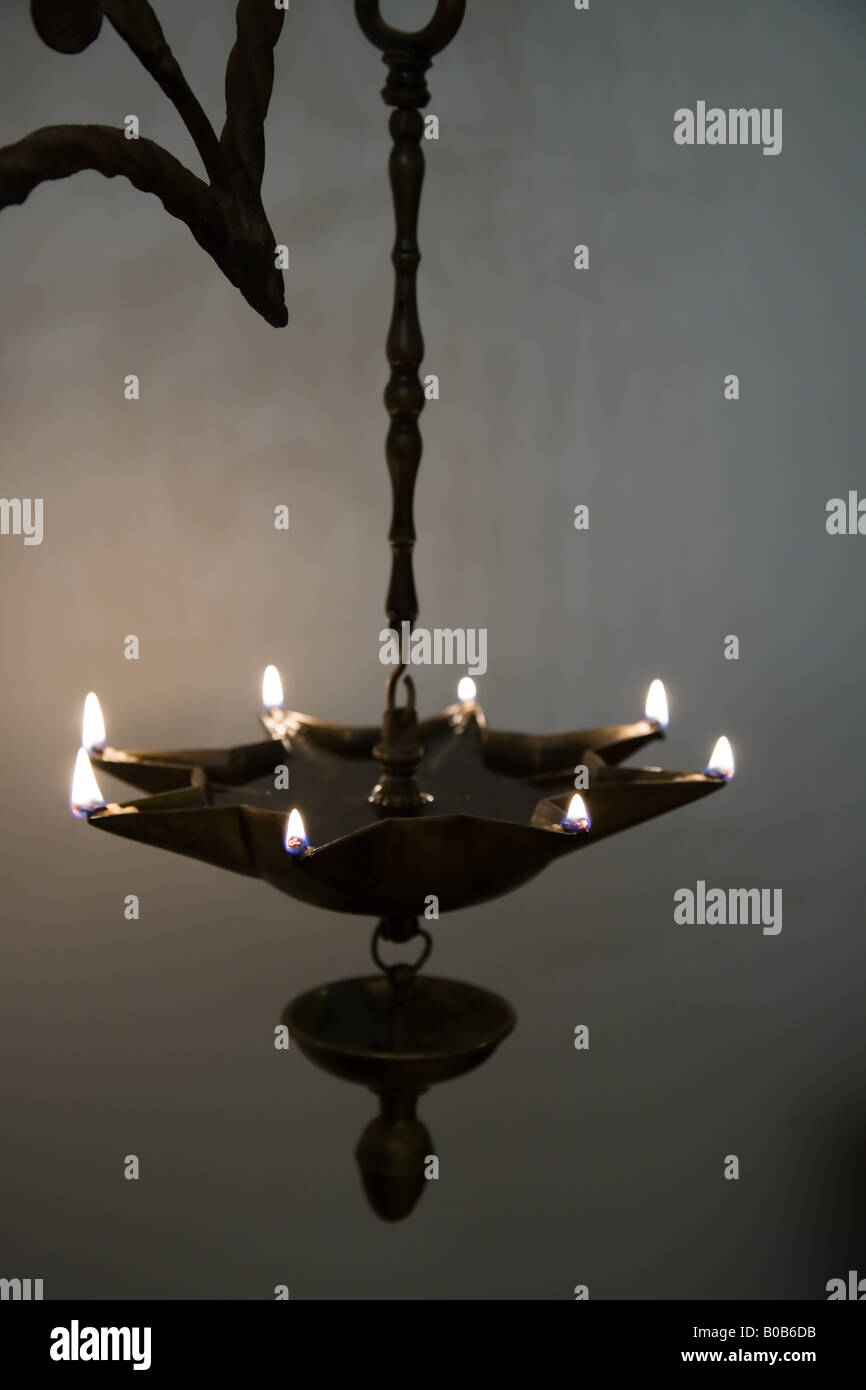 Stock Photo Of A Eight Point Star Antique Oil Lamp Full With Wicks Burning