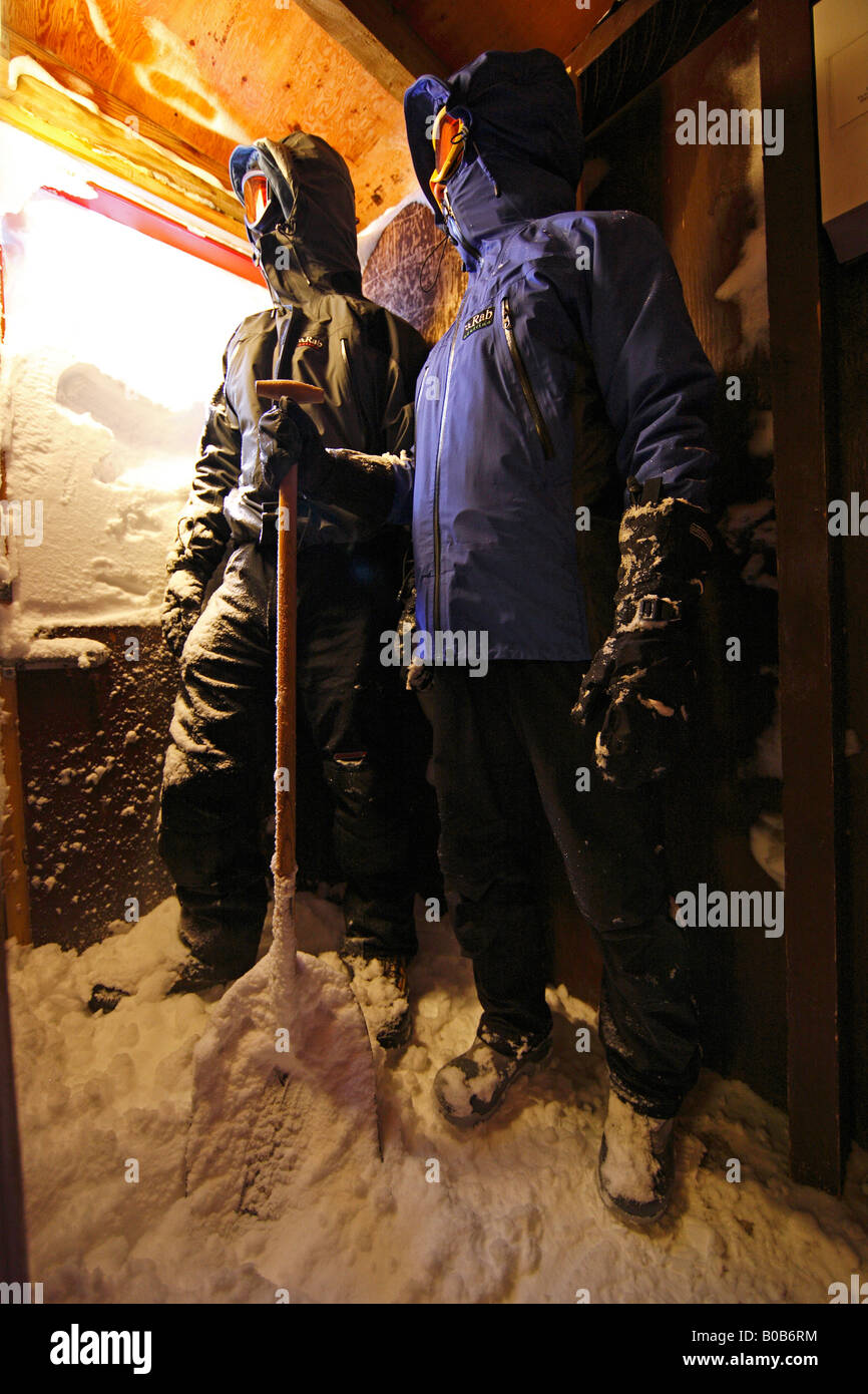 Two men snowed in and about to dig themselves out of the Guesthouse in Ittoqqortoormiit, East Greenland - Stock Image