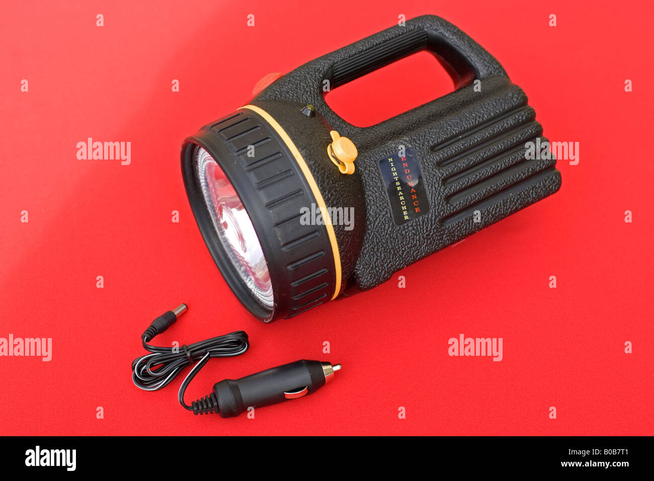 Powerful rechargeable torch with charger UK - Stock Image