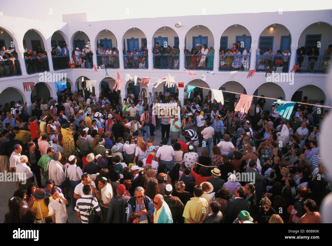 Fund raising auction during  Lag B'Omer Pilgrimage at El Ghriba Synagogue on island of Jerba in Tunisia - Stock Image
