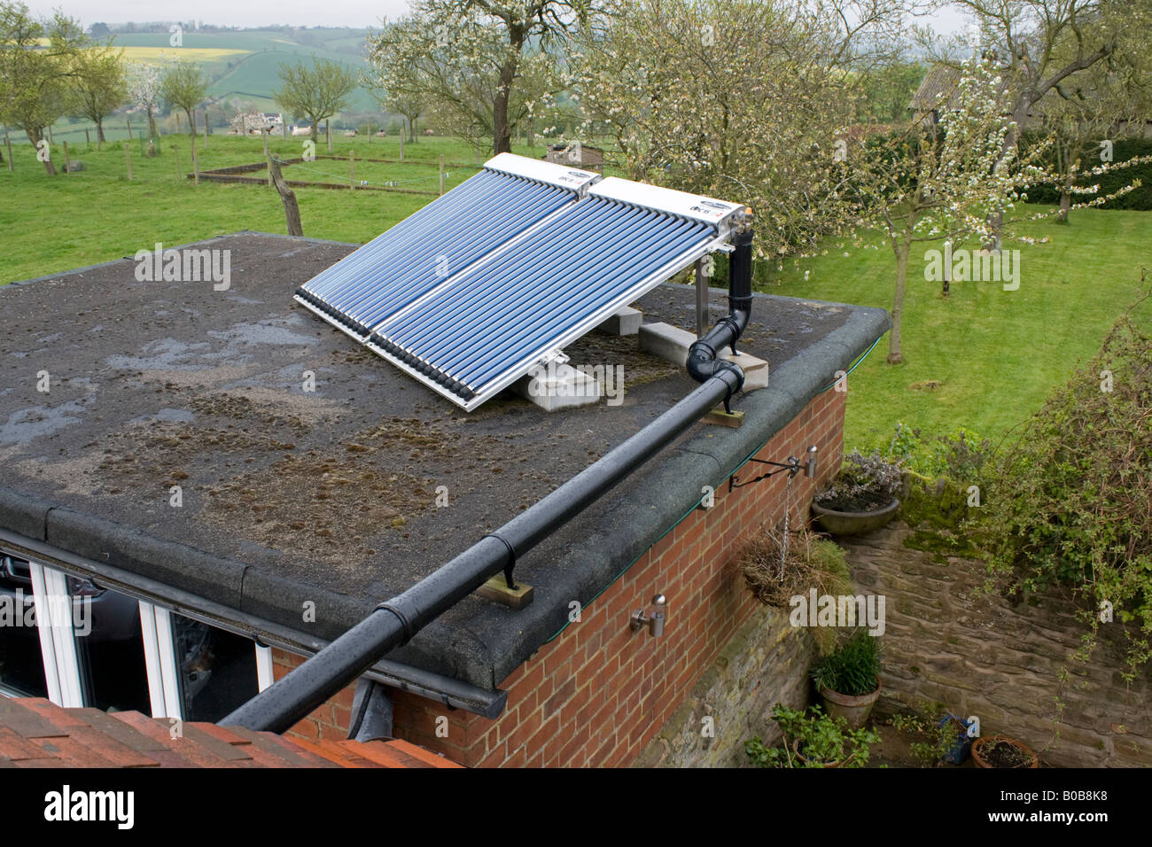 Solar thermal installation Bauer OPC 15 evacuated tubes on roof Bewdley UK - Stock Image
