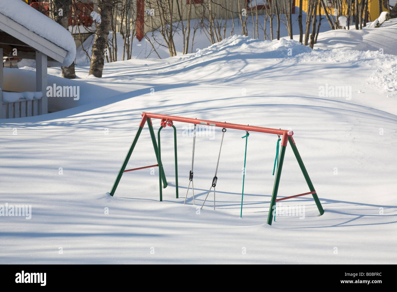 A swing stuck in the snow in winterly Kiruna / northern Sweden - Stock Image