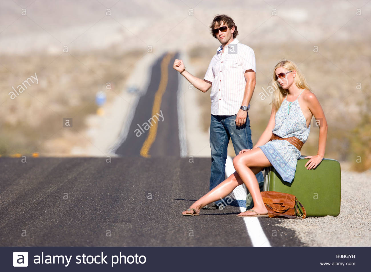 Hitchhikers By Side Of Road >> Hitchhiker Hitchhiking On Road Stock Photos Hitchhiker Hitchhiking