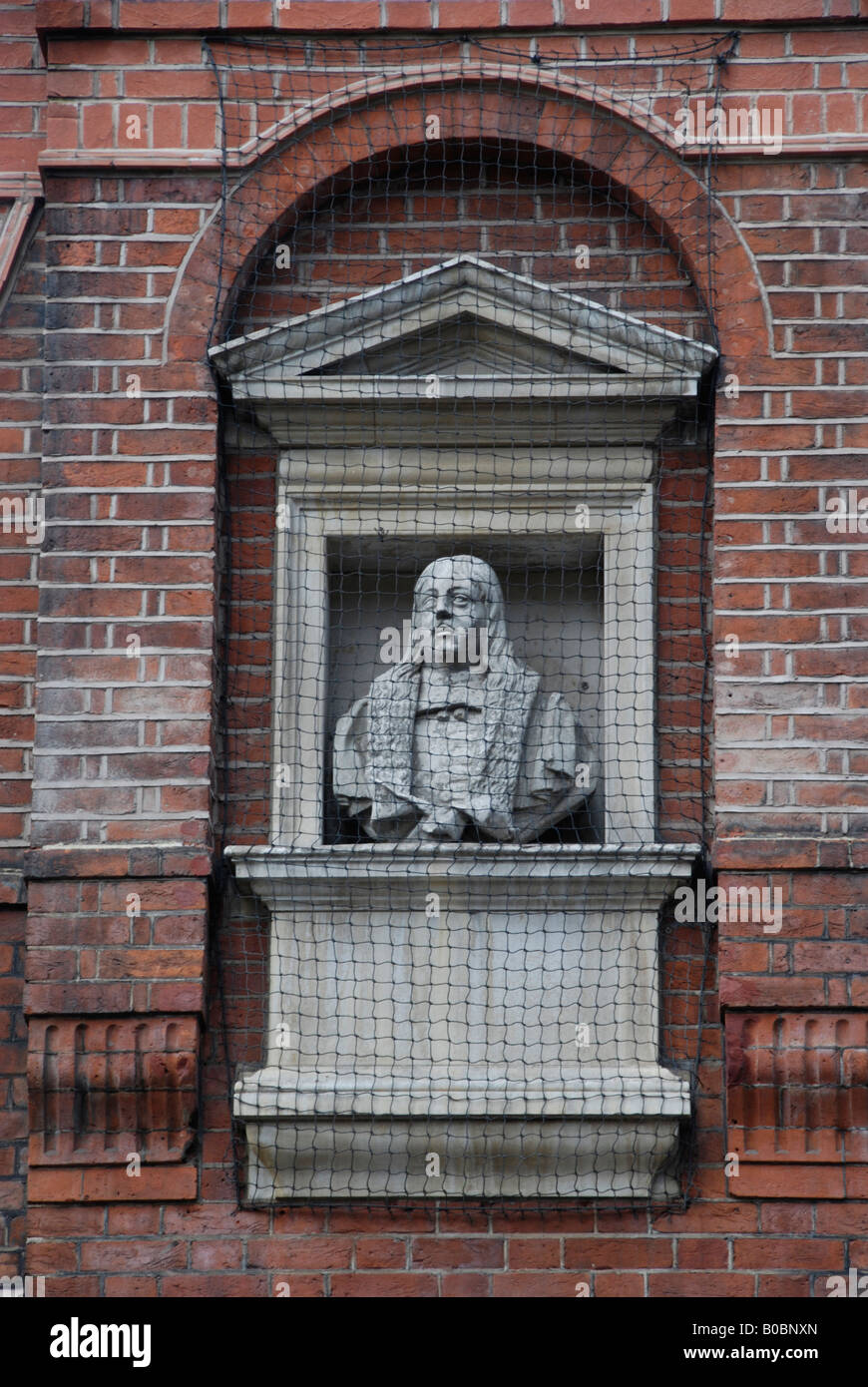 Statue of Emery Hill outside the almshouses he founded in Rochester Row London SW1 - Stock Image