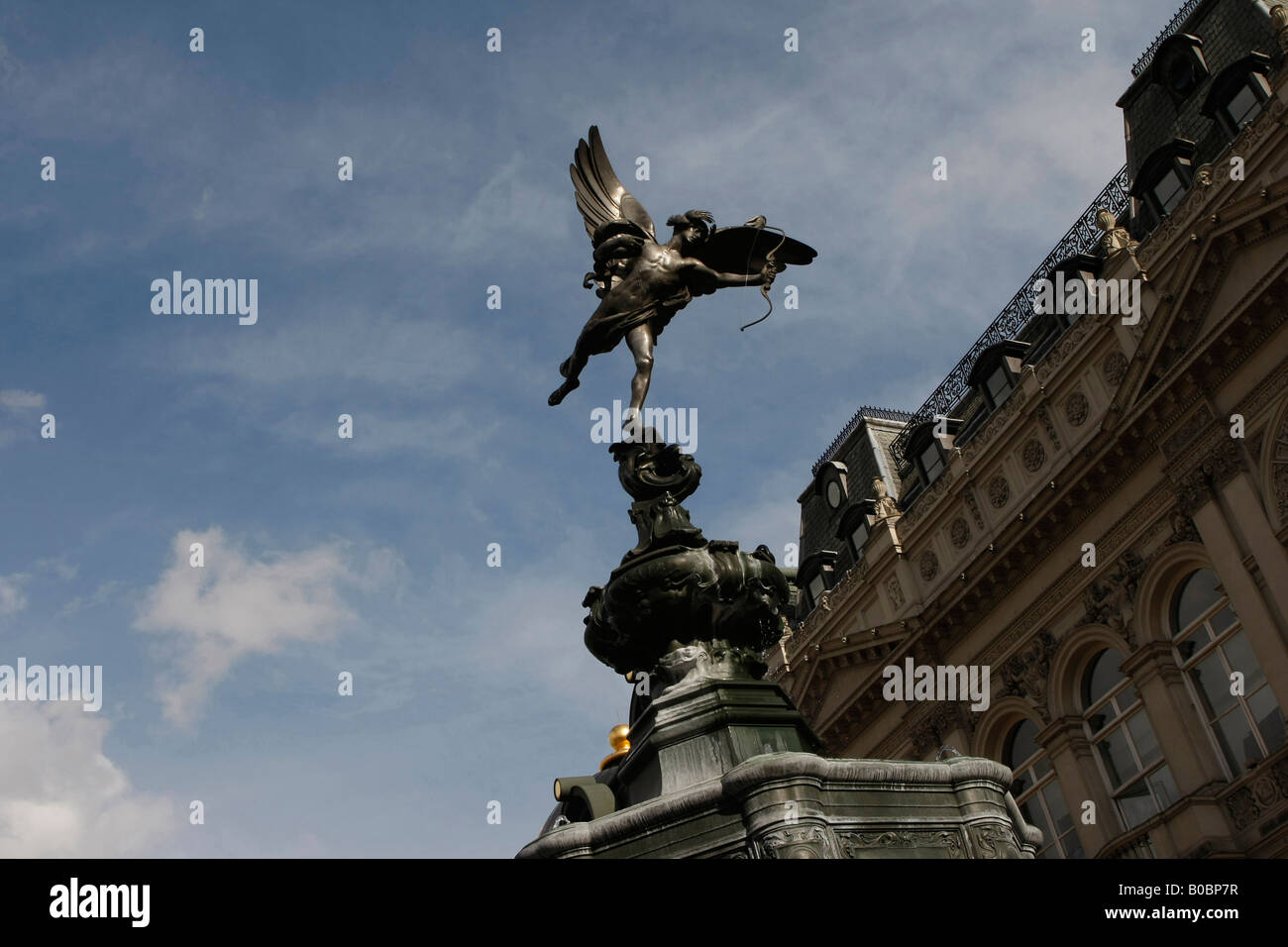 Eros statue in Piccadilly Circus London with the famous Lilywhites store in background - Stock Image