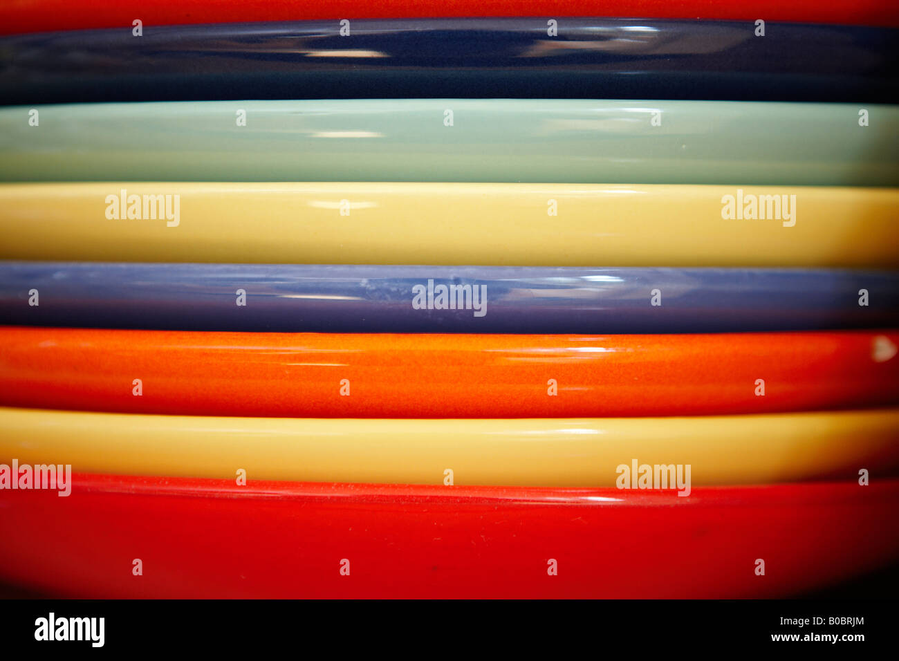Multi-coloured dinner plates. & Multi-coloured dinner plates Stock Photo: 17470396 - Alamy