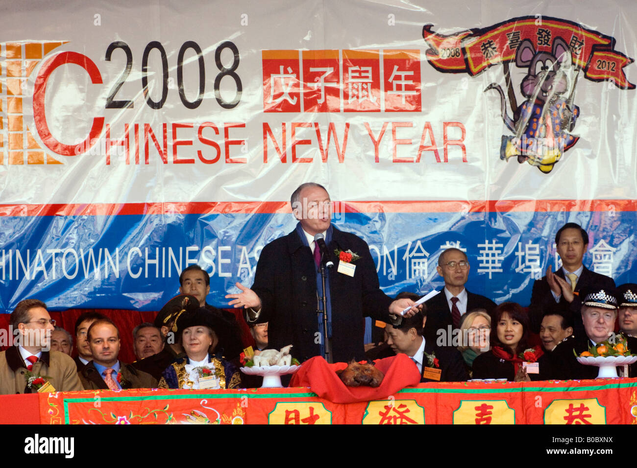 Ex Mayor of London Ken Livingstone and dignitaries addresses the crowd at the opening ceremony of Chinese New Year. - Stock Image