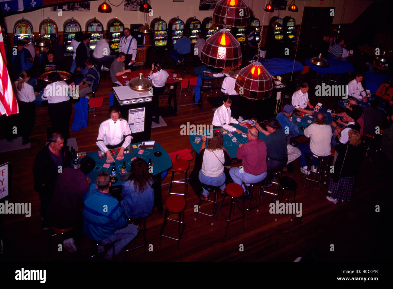 Gambling in Diamond Tooth Gertie's Gambling Hall, Dawson City, Yukon Territory, Canada - Gamblers playing at - Stock Image