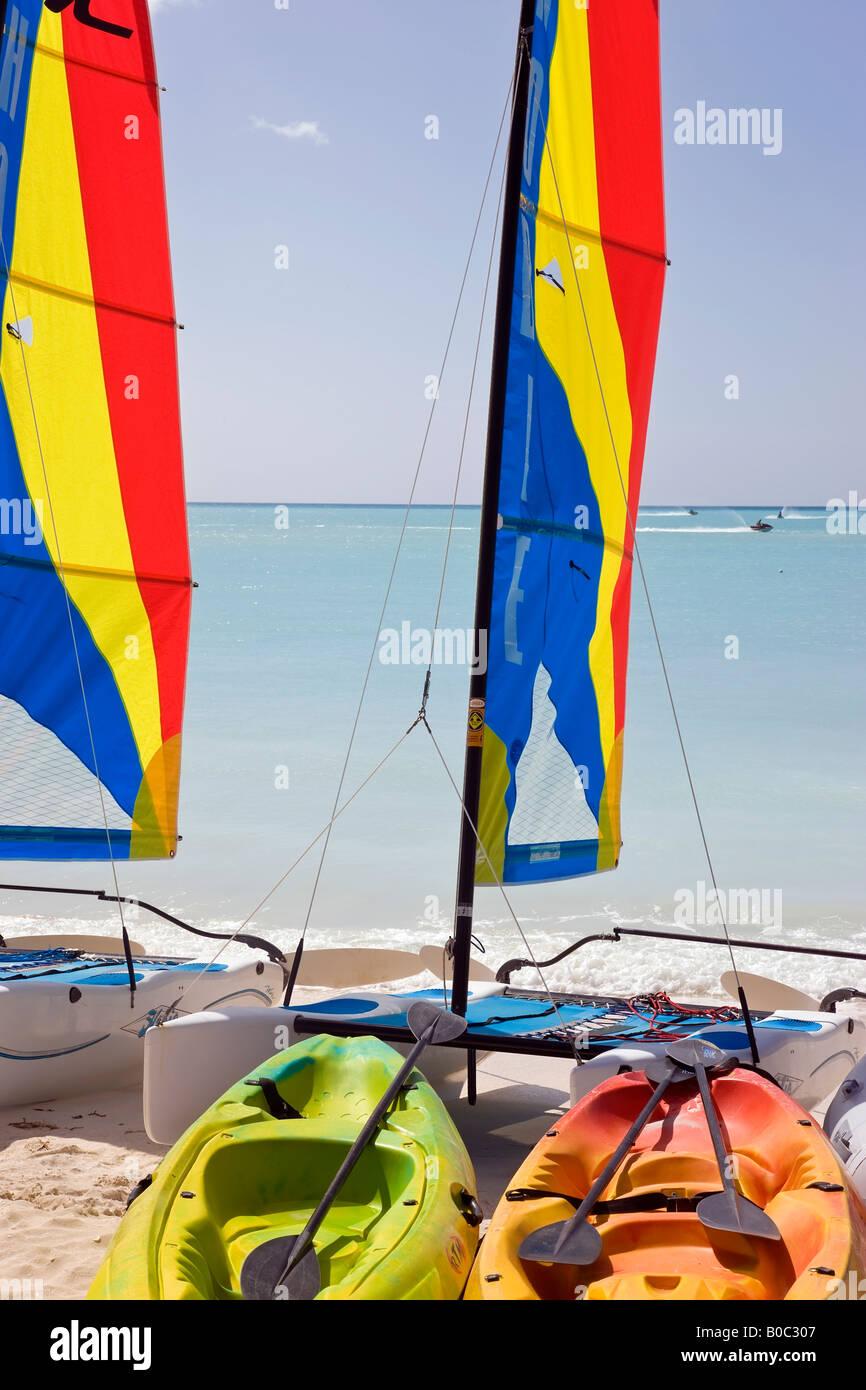 West Indies, Caribbean, Lesser Antilles, Leeward Islands, Antigua and Barbuda, colourful sailboats on Jolly Beach - Stock Image