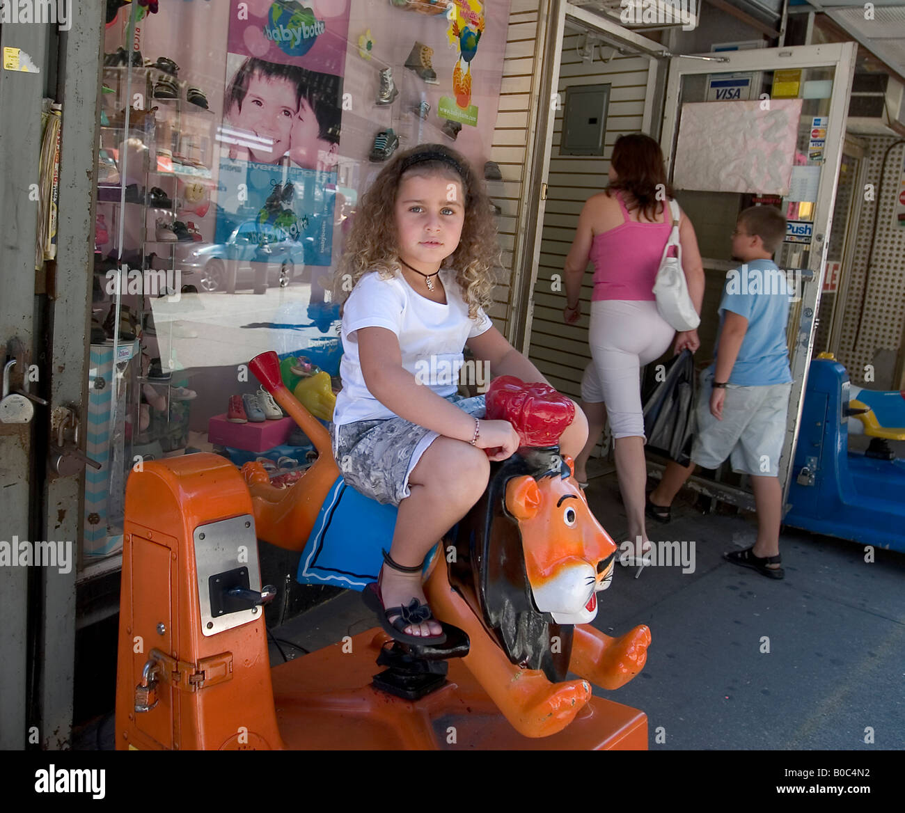 Young girl rides toy speaking