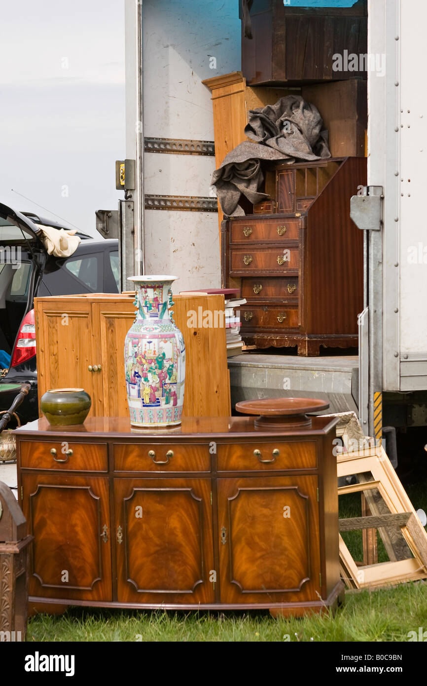 Secondhand furniture on sale at English outdoor car boot sale. Sussex, England - Stock Image